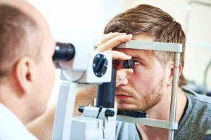 A man receiving an eye exam